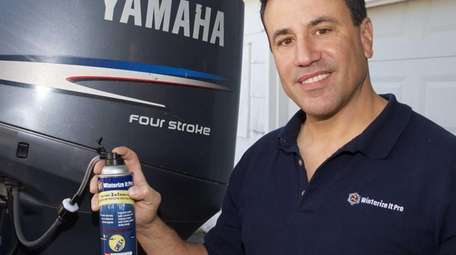 John Drakos with a can of his product,