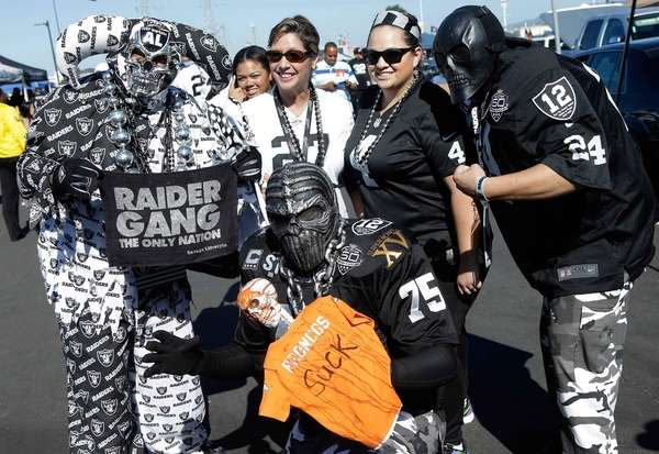Oakland Raiders fans tailgate before an NFL football