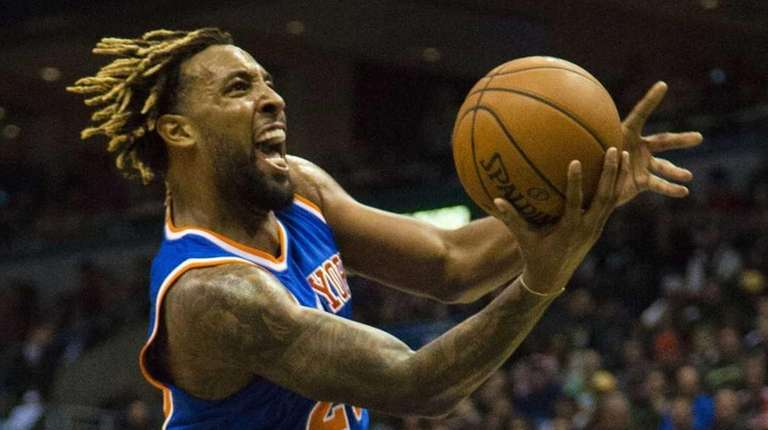 New York Knicks forward Derrick Williams, right, goes