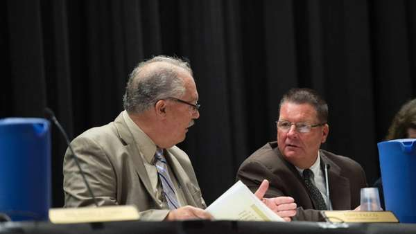 Sachem School Board President Tony Falco, left, and