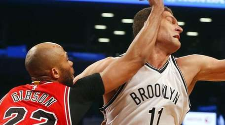 Brook Lopez of the Brooklyn Nets is fouled