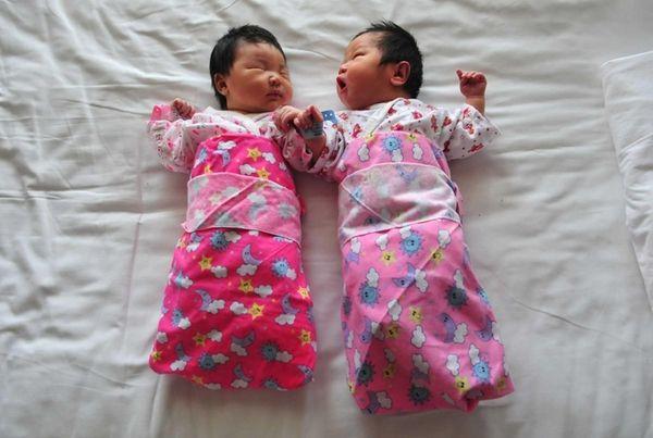 Babies lie in a hospital bed in Beijing,