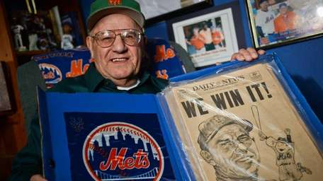 Stan Manel of Holbrook shows off newspaper clippings