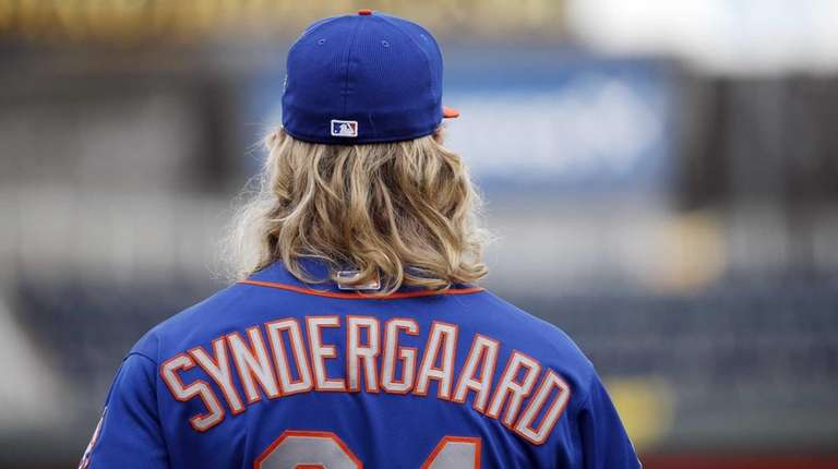 The New York Mets' Noah Syndergaard waits to