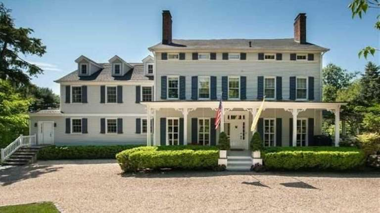 This eight-bedroom Colonial has six full bathrooms and
