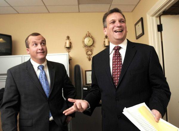 Edward Mangano, right, is shown at his legislative
