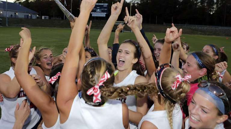 The Miller Place field hockey team celebrates their