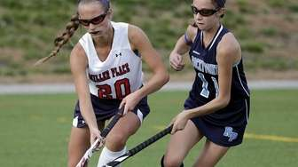 Miller Place's Emily Contrelli (20) controls the ball