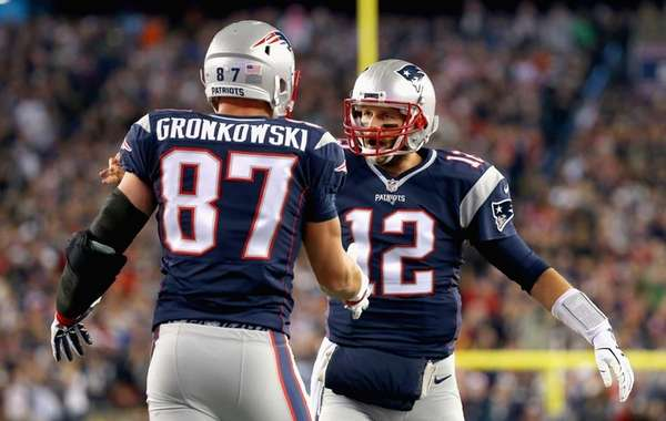 Rob Gronkowski #87 and Tom Brady #12 of