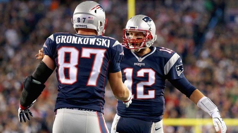Rob Gronkowski #87 and Tom Brady #12 of