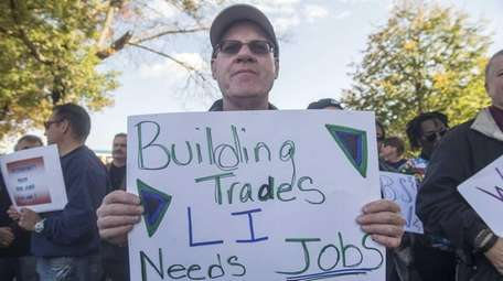 Members of Long Island's construction unions joined officials
