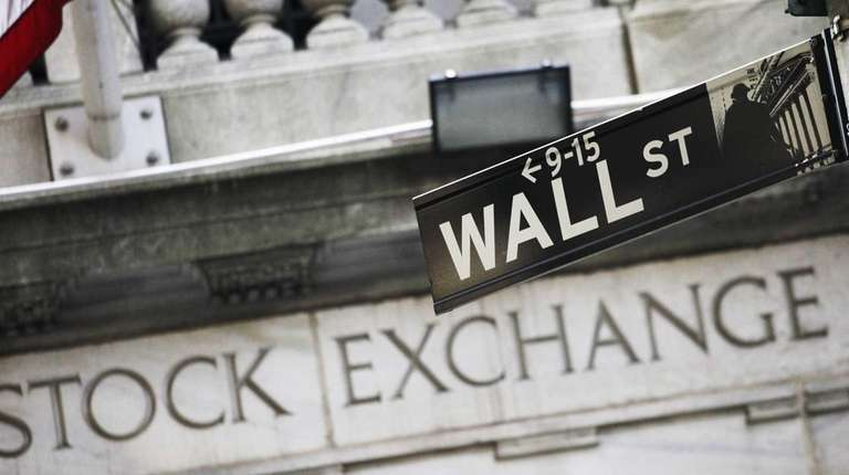 A Wall Street street sign outside the New