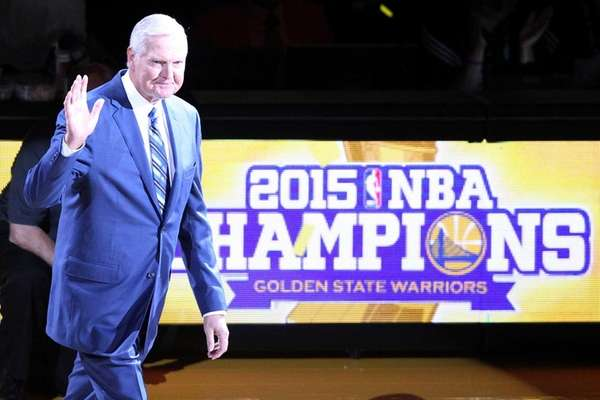 Executive Board Member Jerry West waves to the