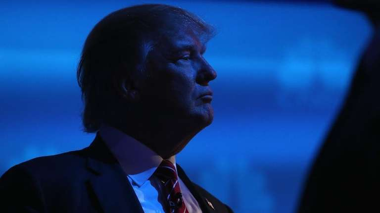 Presidential candidate Donald Trump pauses during a break