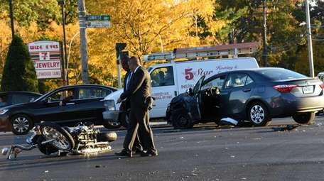 Nassau County detectives investigate the scene of a