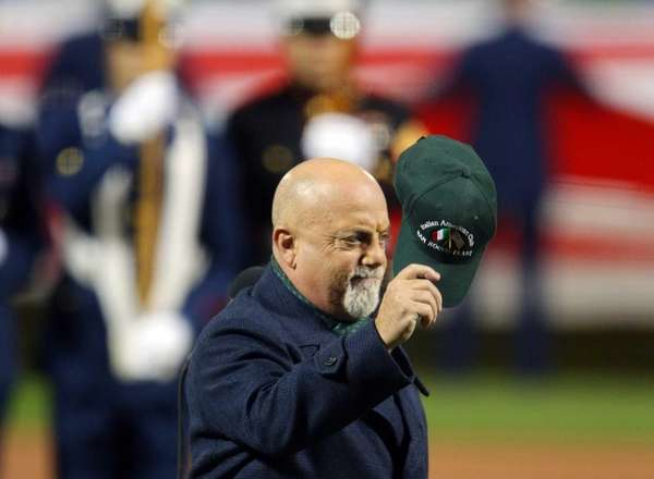 Billy Joel performs the national anthem before Game