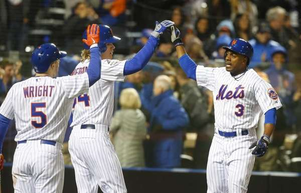 New York Mets rightfielder Curtis Granderson is high-fived