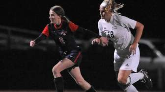 South Side's Alex Churma, left, gets pressured by