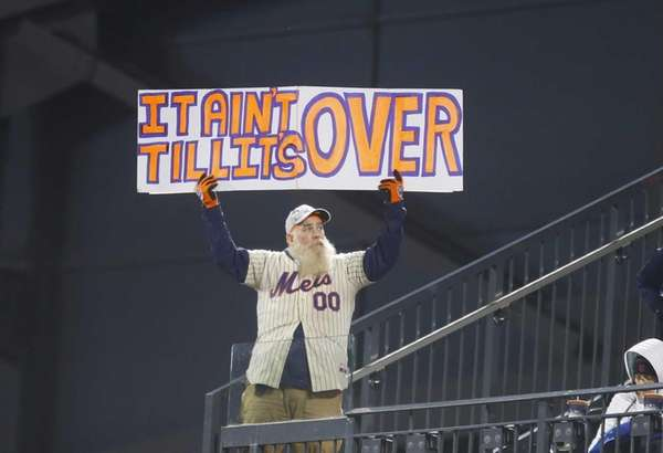 A New York Mets fan holds up a