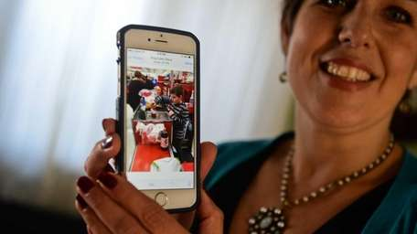 Angela Blanchet shows a photo of her son