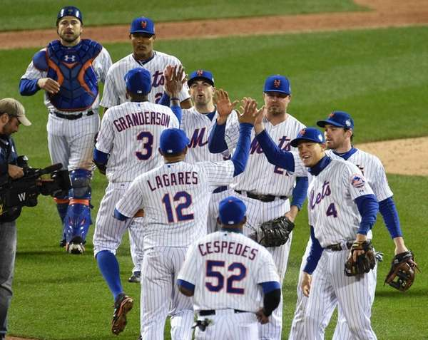 The New York Mets celebrate their 9-3 win