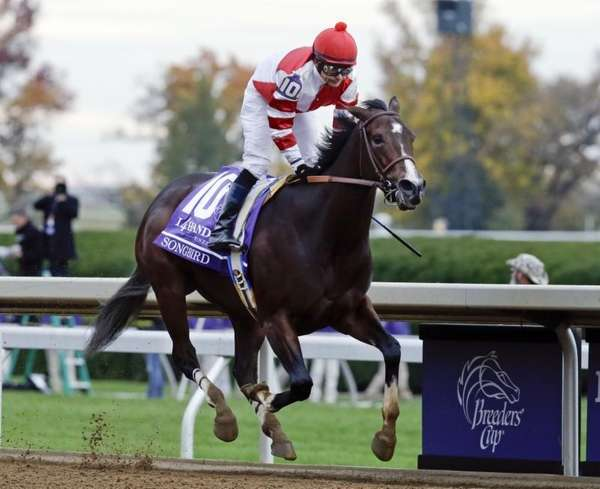 Songbird, with Mike Smith up, wins the Breeders'