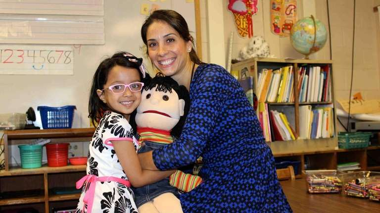 Social worker Dawn Ragone uses a puppet to