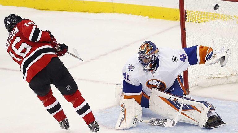 New Jersey Devils center Jacob Josefson scores a