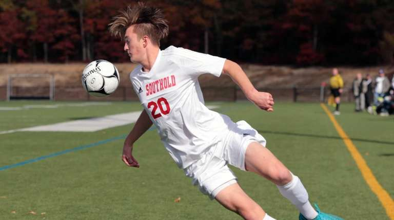 Southold's Alexander Lincoln #20 attempts to keep the