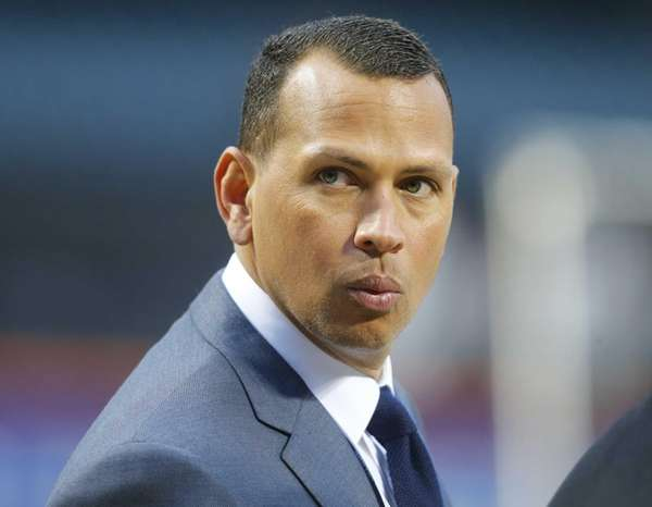 The New York Yankees' Alex Rodriguez looks on