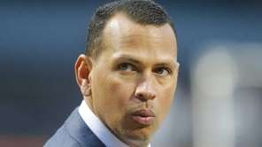 The New York Yankees' Alex Rodriguez looks on