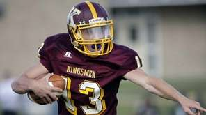 Kings Park quarterback Paul Cooper (13) estures for