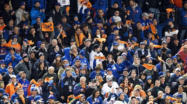 New York Mets fans swing towels before Game