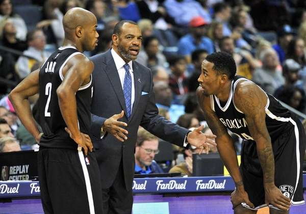 Brooklyn Nets head coach Lionel Hollins, center, talks
