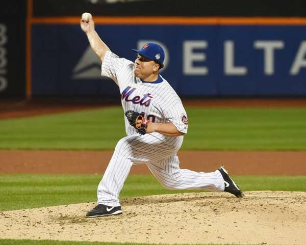 New York Mets starting pitcher Bartolo Colon delivers