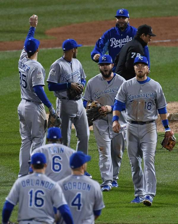 The Kansas City Royals celebrate their 5-3 win
