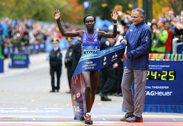 Mary Keitany of Kenya crosses the finish line