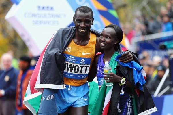 Stanley Biwott, of Kenya, men's division winner, left,