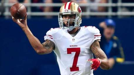 Colin Kaepernick of the San Francisco 49ers throws