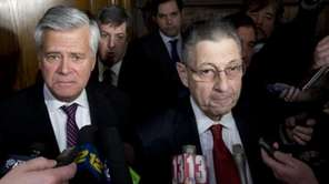 Then-Senate Majority Leader Dean Skelos (R-Rockville Centre), left,