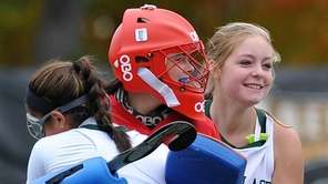 Carle Place goalie Megan McGuinness, center, celebrates with