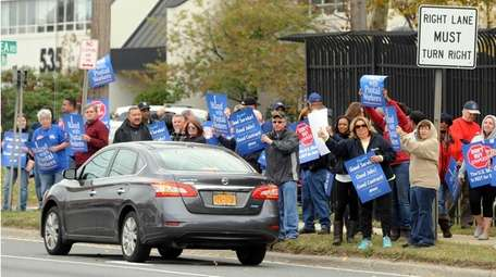Postal workers protest in front of the Mid-Island