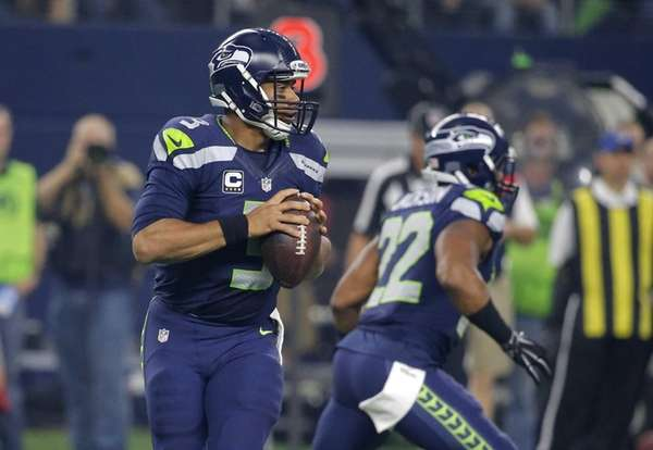 Seattle Seahawks' Russell Wilson (3) prepares to pass
