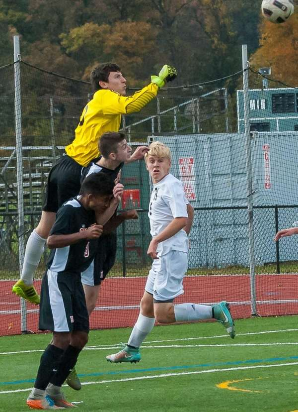 Hicksville's Connor McPartland leaps over the top of