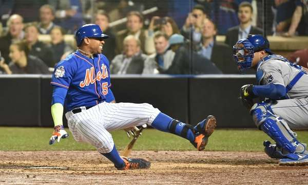 New York Mets centerfielder Yoenis Cespedes falls after