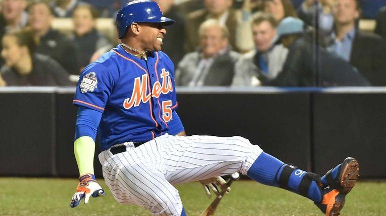 New York Mets centerfielder Yoenis Cespedes falls after