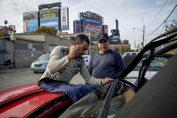 Arturo Olaya, owner of Arthur's Auto Trim, works