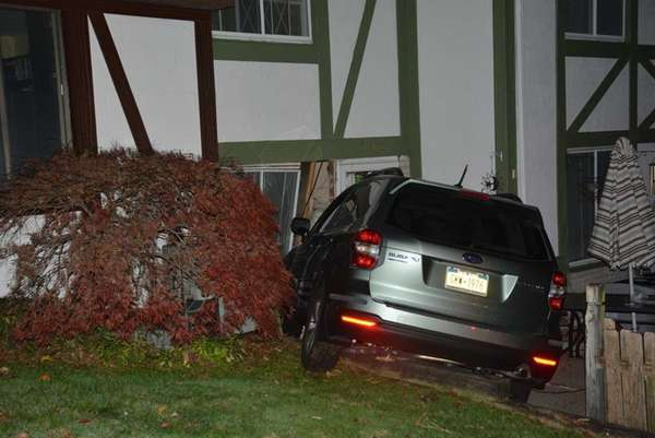 A SUV crashed into a condominium unit in