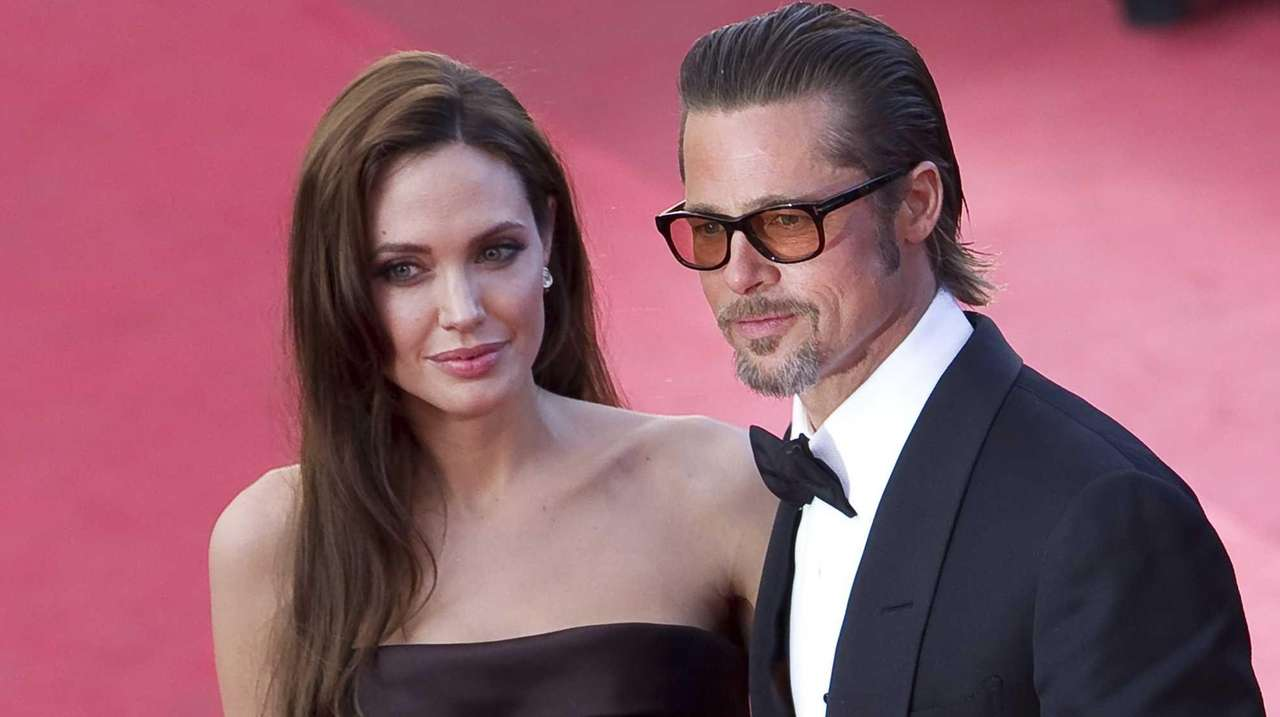 Angelina Jolie and Brad Pitt arrive for the