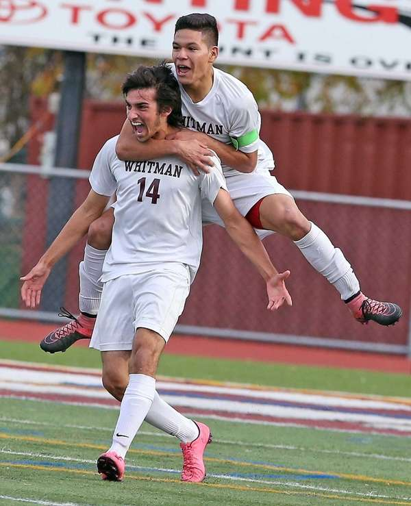 Walt Whitman's Anthony Palazzolo (14) celebrates scoring the